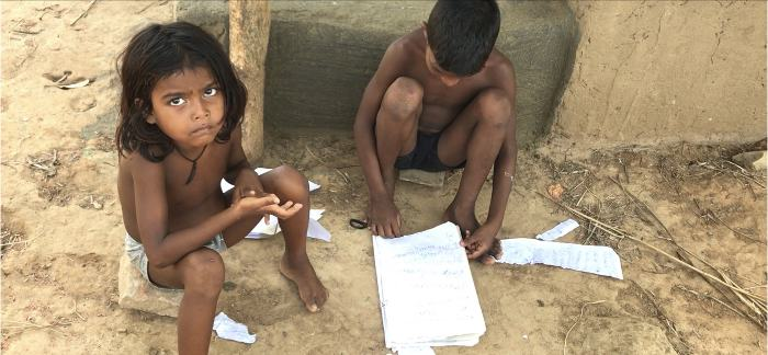 Children trying to salvage their school notes, which are washed away in Fani. Pic: Nidhi Jamwal